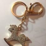 Porte clef doré cheval à bascule
